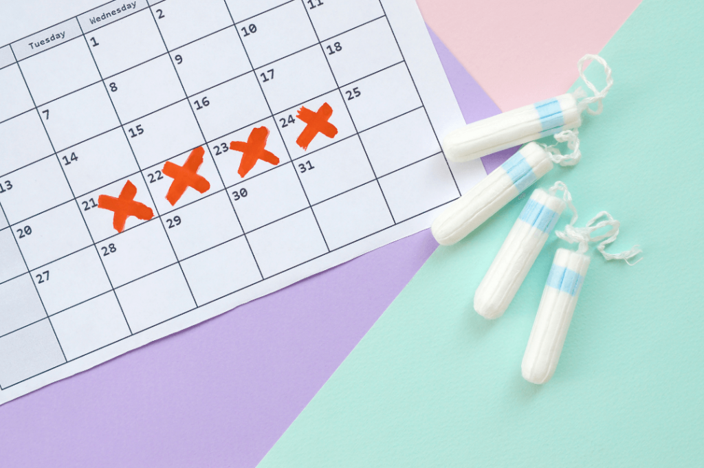 calendar tracking period with red xs and tampons